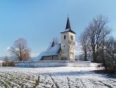 Зимни оглед на All Saints църква в Ludrová