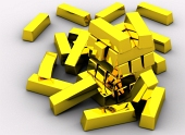 Pile af guldbarrer isoleret på hvid baggrund