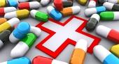 Pillen und rote Kreuz