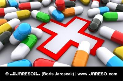 Χάπια και κόκκινο σταυρό