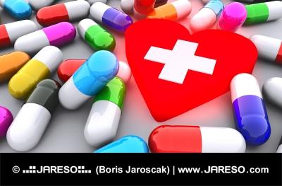Χάπια και λαμπερό κόκκινο καρδιά