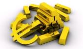 Ράβδους χρυσού και χρυσό σύμβολο του ΕΥΡΩ