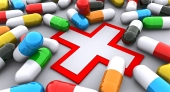 Píldoras y cruz roja