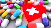 Píldoras y el corazón rojo brillante