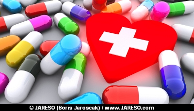 Pills and red glowing heart