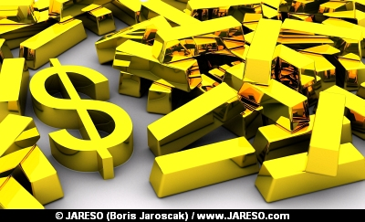 Golden DOLLAR symbol near pile of gold bars