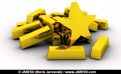 Golden star near pile of gold bars