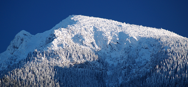 Close up view of snow covered peak of Choc mountain during winter in Slovakia.
