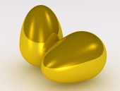 Två gyllene ägg på vit bakgrund