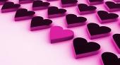 En rosa hjärta mellan en massa svarta hjärtan