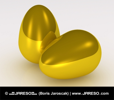 Two golden eggs on white background