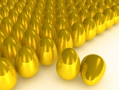 Many golden eggs with two eggs highlighted