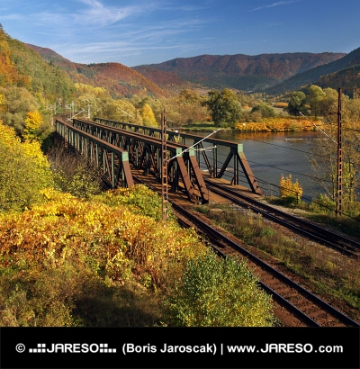 Double track railroad bridge in clear autumn day