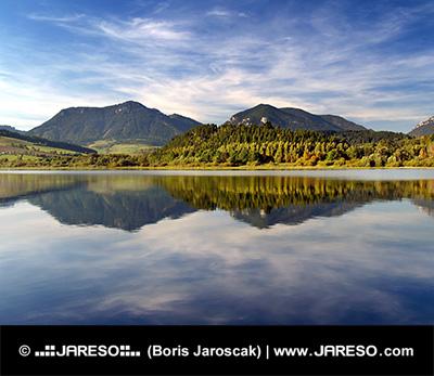 Hills reflected in Liptovska Mara lake at sundown