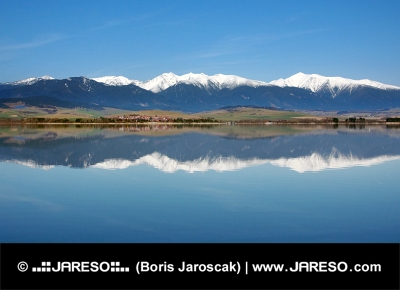 Reflection of snowy Rohace mountains