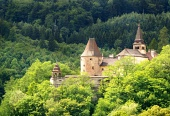 Lower part of Orava Castle hidden in forest
