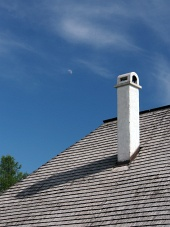 Shingle roof, with chimney and moon